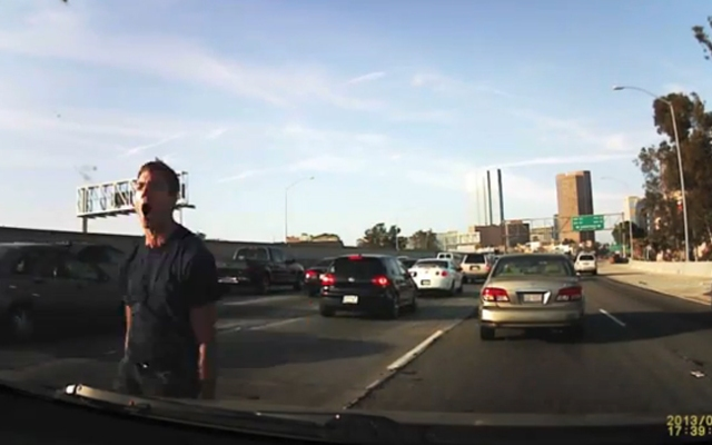 A dashboard-mounted camera video of an apparent road-rage incident on a Los Angeles freeway in June 2013 has gone viral.