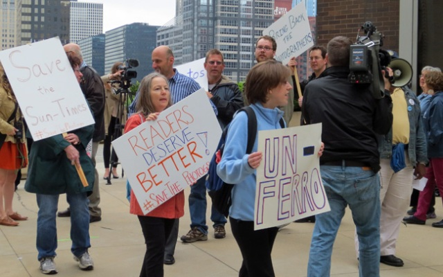 Laid off photographers and their supports demonstrate in front of the Chicago Sun-Times.