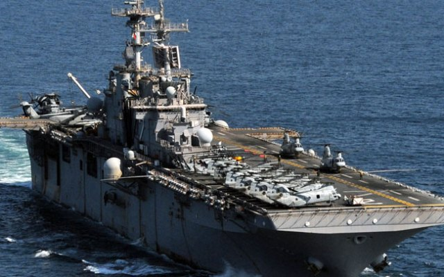 The forward-deployed amphibious assault ship USS Essex (LHD 2) steams in formation with the Japan Maritime Self Defense Force Ship JS Hyuga (DDH 181) on April 6, 2011.