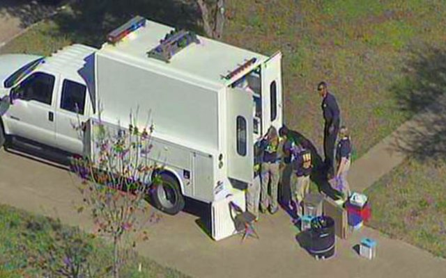 Local, state and federal agents search home of Eric Williams in Kaufman Friday afternoon.
