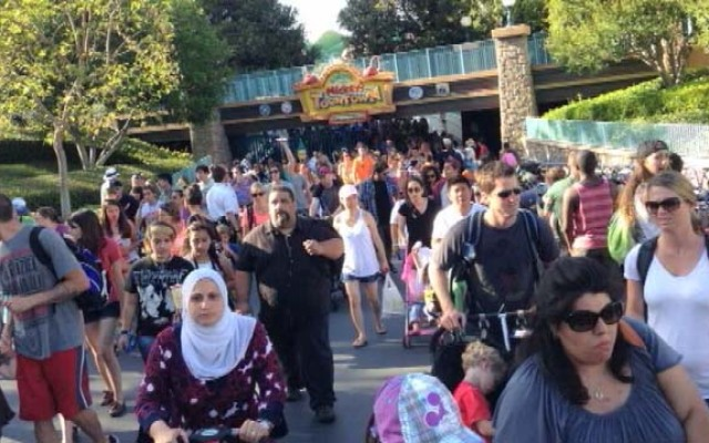 Throngs of visitors leave Disneyland's Toontown on May 28, 2013, after a loud explosion went off, caused by what may have been dry ice in a water bottle.