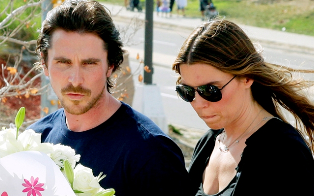 Actor Christian Bale and his wife Sibi Blazic visit a memorial to the victims of the mass shooting at the midnight showing for