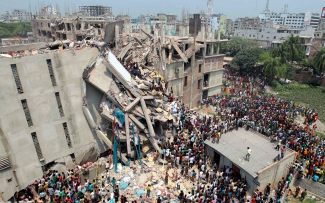 People and rescuers gather after an eight-story building housing several garment factories collapsed in Savar, near Dhaka, Bangladesh on Wednesday, April 24th. Many were killed and many more are feared trapped in the rubble.
