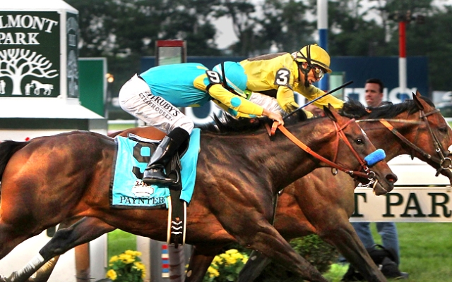 John Velazquez, riding Union Rags and the wearing yellow silks, won the 2012 Belmont Stakes by a nose.