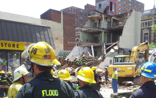 A building collapses on top of Salvation Army Thrift Store in Center City Philadelphia on Wednesday, June 5, 2013.
