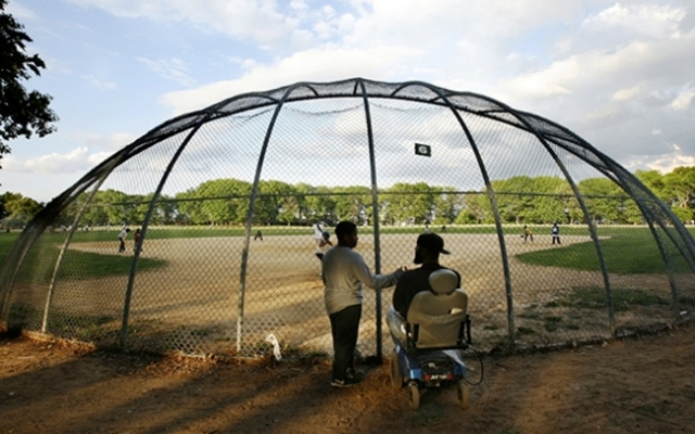 Newark Eagles Little League team player William Jones gives Coach Rodney Mason a high-five as he arrives at practice at the practice field at Weequahic Park on May 15, 2008.