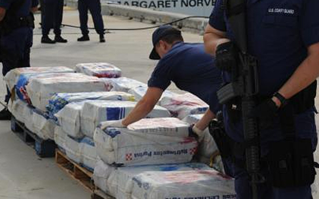 Coast Guard crews unload 2,300 pounds of cocaine, worth $35 million.