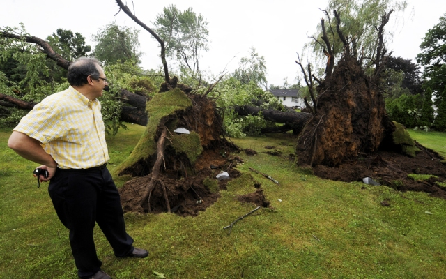 Three years ago, Bridgeport experienced a tornado much like the one that hit Windsor Locks and East Windsor Monday afternoon. This man surveys tornado damage at a Windsor Locks home.