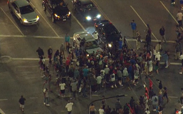 A crowd gathers at an intersection Monday July 15, 2013 near Leimert Park during the second night of protests and violence following the acquittal of George Zimmerman in Florida.