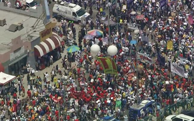 Hundreds were gathered just before 1 p.m. at the intersection of Broadway and Olympic in downtown Los Angeles for a May Day march on May 1, 2013.