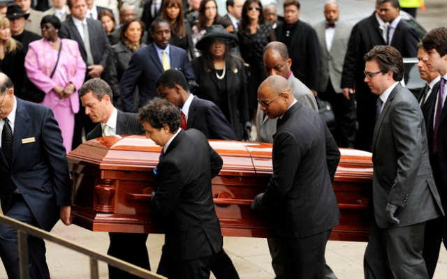 Pallbearers carry the casket of film critic Roger Ebert before his funeral at Holy Name Cathedral in Chicago, Monday, April 8, 2013. Ebert died Thursday, April 4, 2013, at age 70 after a long battle with cancer.