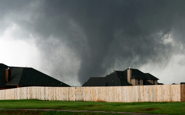 A tornado moves past homes in Moore, Okla. on Monday, May 20, 2013. (AP Photo/Alonzo Adams)