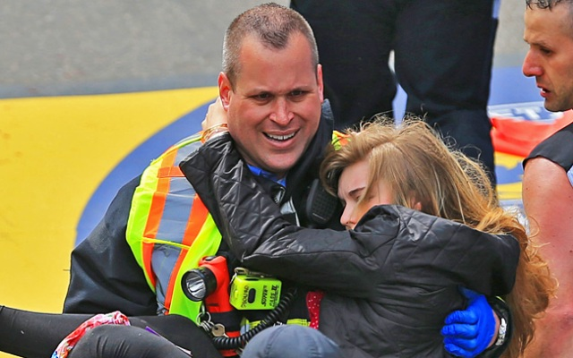 BOSTON - APRIL 15: Emergency personnel respond to the scene after two explosions went off near the finish line of the 117th Boston Marathon on April 15, 2013. (Photo by David L. Ryan/The Boston Globe via Getty Images)