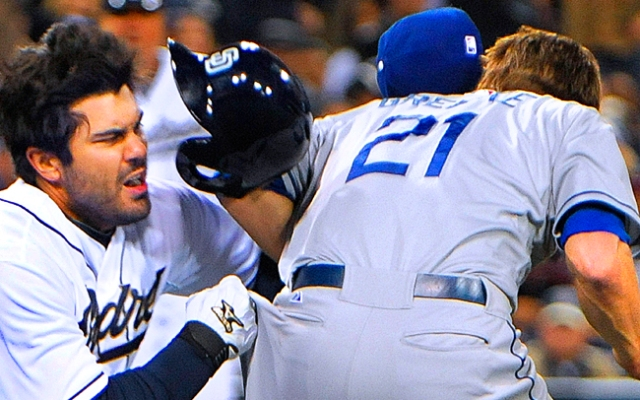 SAN DIEGO, CA - APRIL 11: Carlos Quentin #18 of the San Diego Padres slams into Zack Greinke #21 of the Los Angeles Dodgers as he charges the mound during the sixth inning at Petco Park on April 11, 2013 in San Diego, California. (Photo by Denis Poroy/Getty Images)