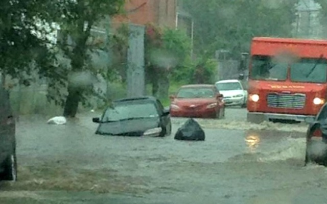 Heavy rains flooded cars on Hillside Avenue in Hartford on Tuesday.
