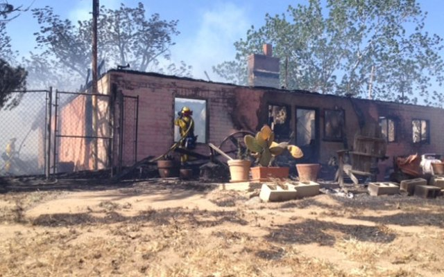 At least one home has burned in the Summit Fire on May 1, 2013. This residence, which appeared entirely gutted, is on Mesa Street at Sunset Avenue.