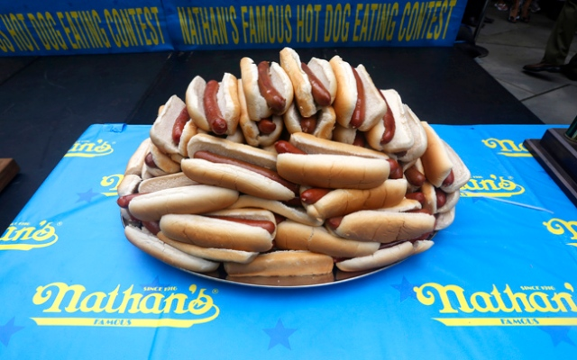 On July 4, competitive eaters face off in an annual hot dog eating contest in Coney Island, New York. Hot dogs are on display during the official weigh-in for the 97th Nathan's Fourth of July hot dog eating contest, Wednesday, July 3, 2013 at City Hall park in New York. Click through to see more photos of the contest.