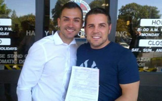 Paul Katami and Jeff Zarrillo, two of the plaintiffs in a challenge to Proposition 8, California's ban on same-sex marriage, pose with their marriage license on Friday, June 28, 2013. A federal appellate court on Friday issued an order clearing the way for same-sex weddings to resume.
