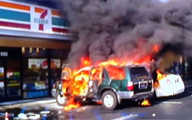 A man was set on fire while sitting in his sport utility vehicle in the parking lot of a 7-11 near Pacific Coast Highway and Clark Avenue in Long Beach. A witness captured this cellphone footage of the attack on Friday, April 12, 2013.