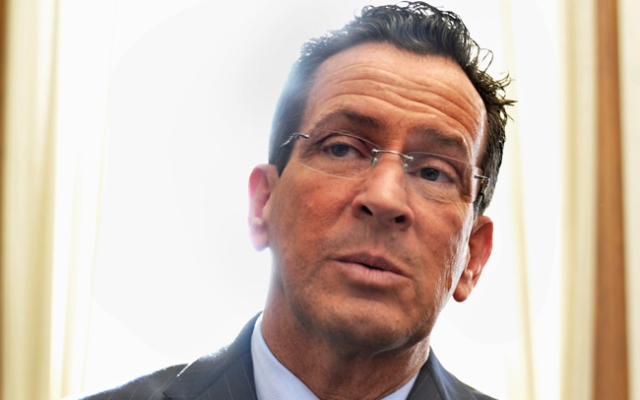 Connecticut Gov. Dannel P. Malloy addressed the situation in Libya as he travels in China.