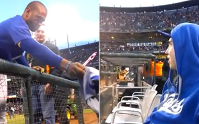 Post-game, Dodgers' Matt Kemp gives a fan his jersey, hat, cleats and a handshake on Sunday, May 5, 2013. These still images are composed from two separate shots in the YouTube video.