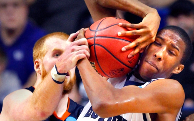 Butler forward Kameron Woods wrestles with Bucknell's Joe Willman, left, for a rebound during the second half of their second-round game in the NCAA college basketball tournament Thursday, March 21, 2013, in Lexington, Ky. Butler won 68-56. Click to see more great photos from the 2013 NCAA Tournament.
