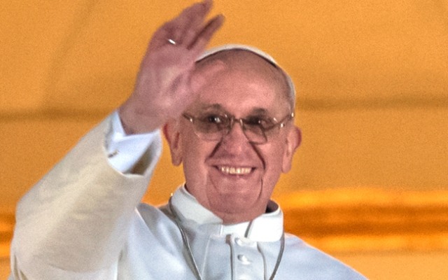 Argentina's Jorge Bergoglio, elected Pope Francis I waves from the window of St Peter's Basilica's balcony after being elected the 266th pope of the Roman Catholic Church on March 13, 2013 at the Vatican.      AFP PHOTO / VINCENZO PINTO        (Photo credit should read VINCENZO PINTO/AFP/Getty Images)