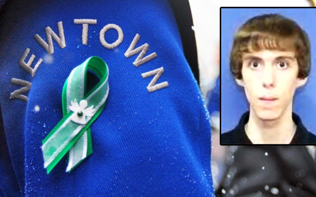 A green and white ribbon, the colors of Sandy Hook Elememtary School in Newtown, Conn., is seen on the uniform of a Newtown High School Marching Band member after marching in the St. Patrick's Day Parade on Saturday March 16, 2013 in New York. The band, from Newtown, Conn., wore the ribbons in remembrance of the victims of the shooting at Sandy Hook Elementary School.