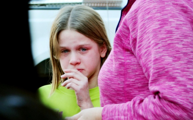 A young girl cries following a shooting at the Sandy Hook Elementary School in Newtown, Conn., about 60 miles (96 kilometers) northeast of New York City, Friday, Dec. 14, 2012. An official with knowledge of Friday's shooting said 27 people were dead, including 18 children. (AP Photo/The New Haven Register, Melanie Stengel)