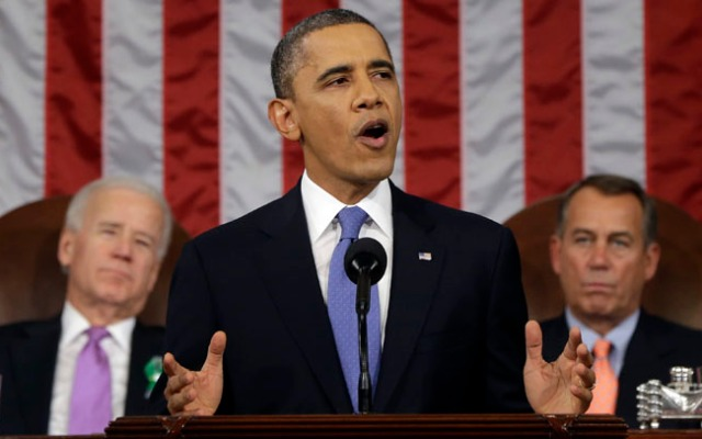 President Barack Obama, flanked by Vice President Joe Biden and House Speaker John Boehner of Ohio, gives his State of the Union address during a joint session of Congress on Capitol Hill.