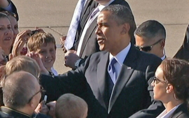 The president shook hands with members of the public gathered on the tarmac of Moffett Field.