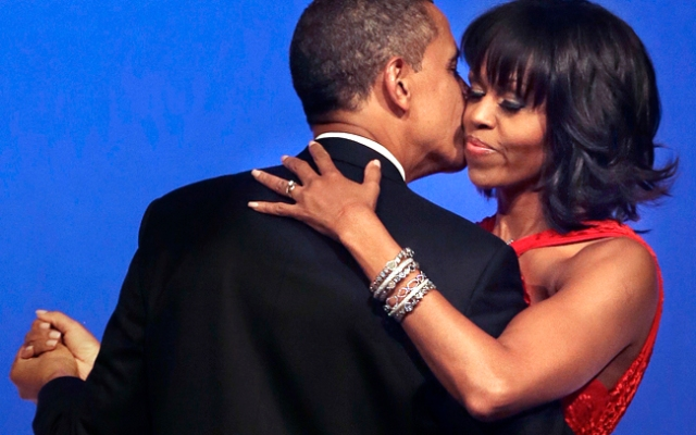 President Barack Obama kisses first lady Michelle Obama during their dance at the Commander-in-Chief Inaugural Ball.