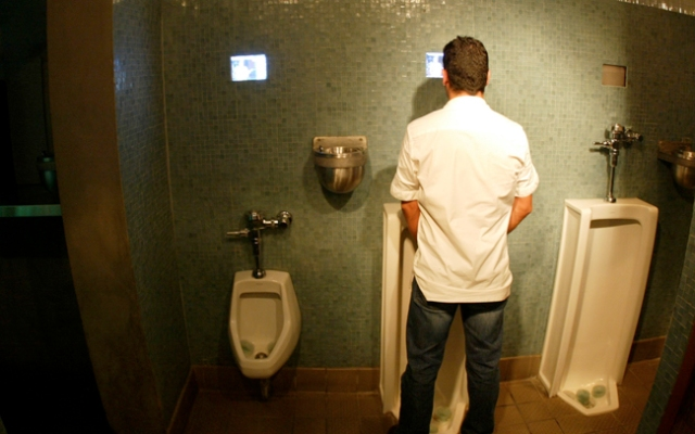A urinal gaming system is coming to the men's rooms of Coca-Cola Park in the Lehigh Valley. This image shows televisions in the men's room of a Miami Beach club.