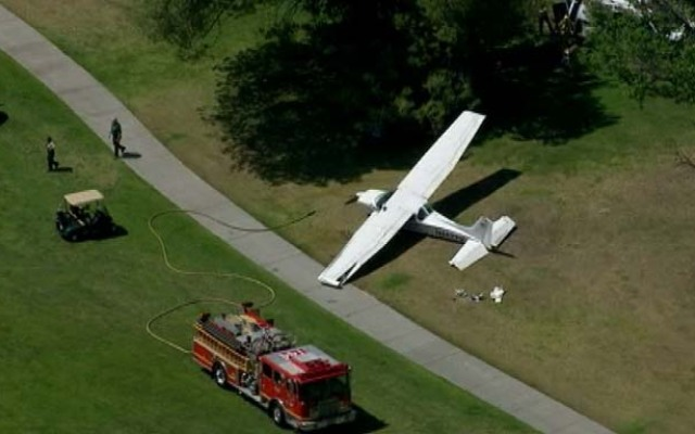 A single-engine Cessna lands near the third hole on Westlake Golf Course on Monday, April 29, 2013.