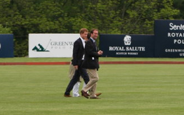 Prince Harry crosses the polo grounds before the match begins.