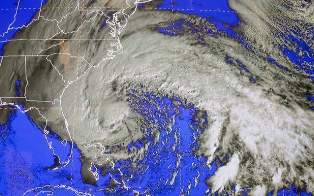 The National Oceanic and Atmospheric Administration said the National Weather Service did a good job predicting the movements of Hurricane Sandy but did not provide enough timely information about massive storm surges.