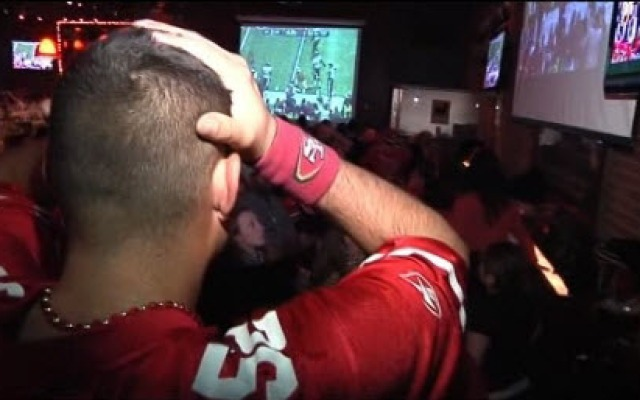 A San Francisco 49er fan reacts at Pete's in San Francisco to his team losing the Super Bowl.