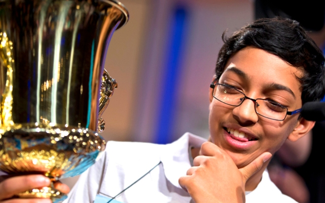 Arvind Mahankali, 13, of Bayside Hills, New York holds the championship trophy after he won the National Spelling Bee.
