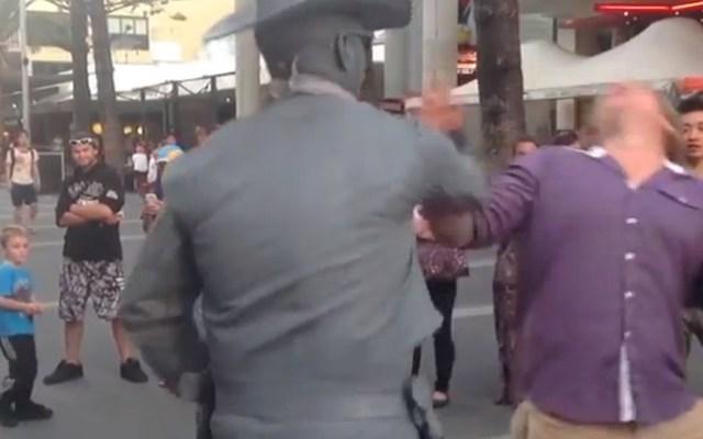 Street performer David Mulder seen here punching a heckler.