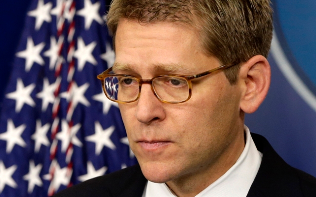 White House press secretary Jay Carney listens to a follow up question regarding the school shooting in Newtown, Conn.