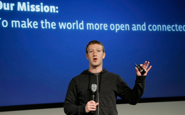 FILE- In this Thursday, March 20, photo, Facebook CEO Mark Zuckerberg speaks at Facebook headquarters in Menlo Park, Calif. A research firm expects Facebook�s mobile ad revenue to soar this year, hitting nearly $1 billion a year after the company started to splice ads into its users� mobile phones and tablets. (AP Photo/Jeff Chiu)