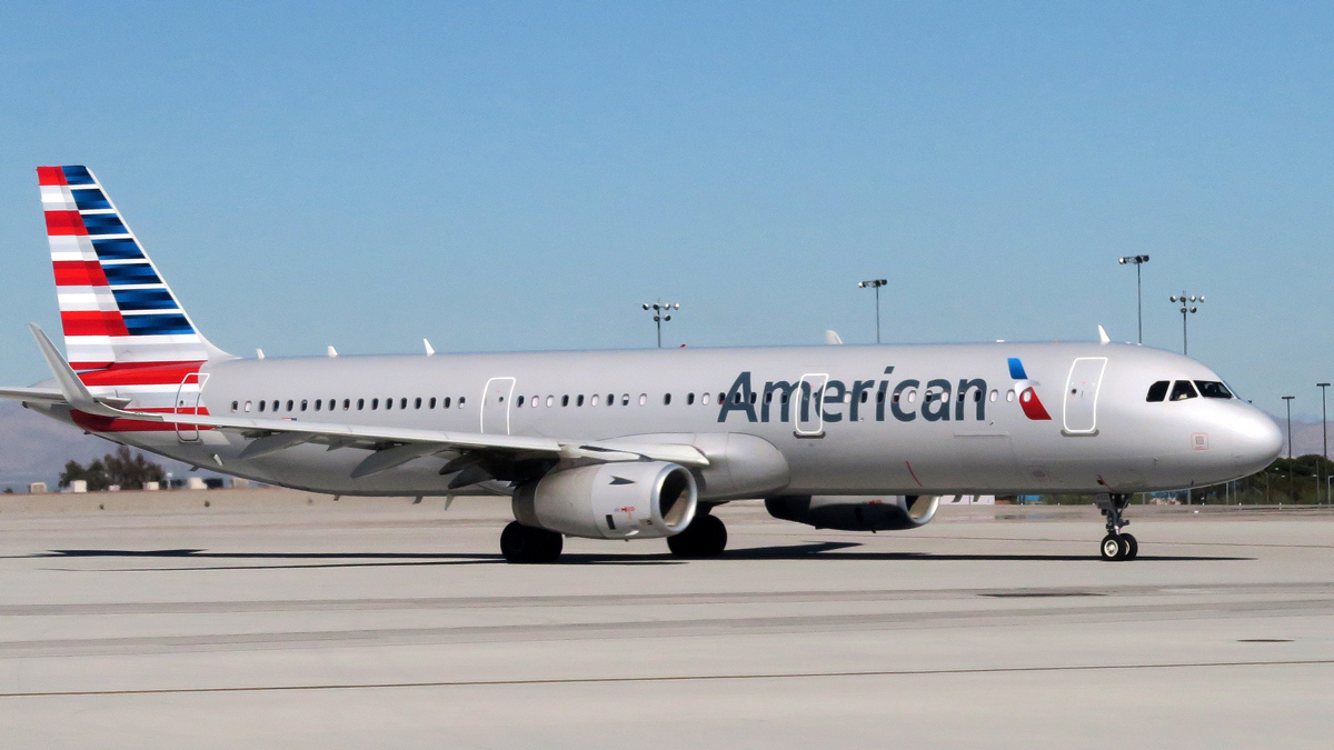 In this Feb. 15, 2017 file photo, an American Airlines plane sits on the tarmac of McCarran International Airport in Las Vegas, Nevada. American Airlines is being sued by an Australian traveler who says he suffered injuries after being seated next to two obese seat mates for a 14-hour flight.