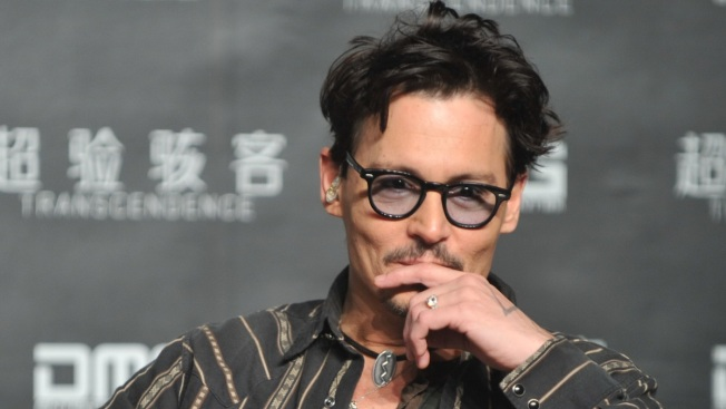 """Johnny Depp Confirms Engagement, Shows Off """"Chick's Ring"""""""