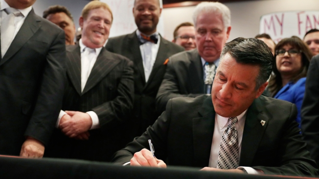 Sandoval signs bill raising tax for Vegas football stadium