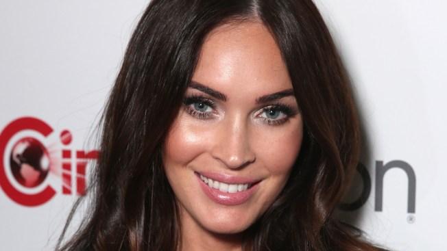 Megan Fox Debuts Baby Bump on CinemaCon Red Carpet