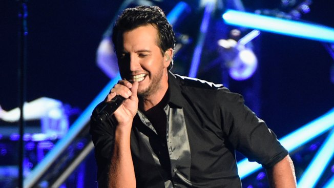Luke Bryan Slaps Heckler From Stage With Microphone in Hand