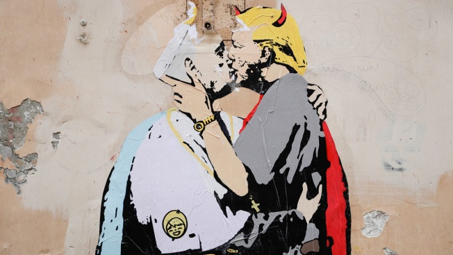 Mural of saintly pope kissing devilish Trump appears in Rome