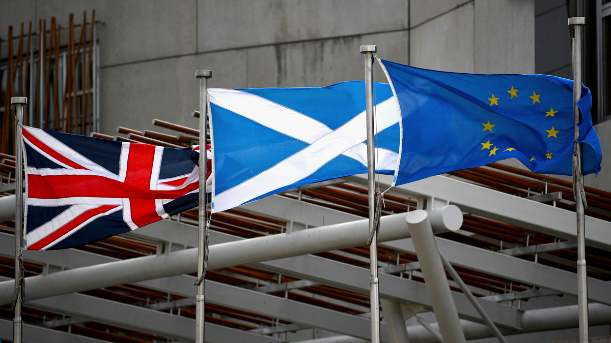 Saltire, Union Jack and European Union flags flutter in the wind outside the Scottish Parliament on March 13, 2017, in Edinburgh, Scotland. Scotland's First Minister Nicola Sturgeon has confirmed she will ask for permission to hold a second Scottish independence referendum. (Photo by Jeff J Mitchell/Getty Images)