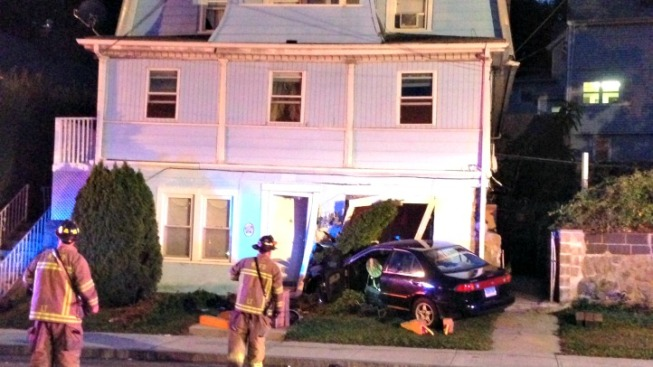 Car Slams Into Home in New London
