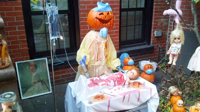 Halloween Display of Jack-o'-Lantern Operating on Bloody Doll Causes Alarm